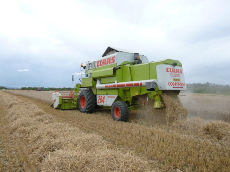 OUR CLAAS 204 WORKING AWAY DOWN THE ROAD,,